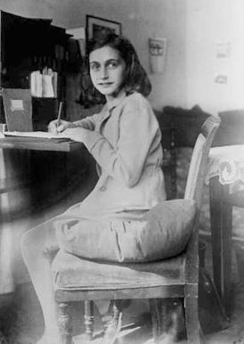 Anne Frank writing at her desk, Merwedeplein, 1941